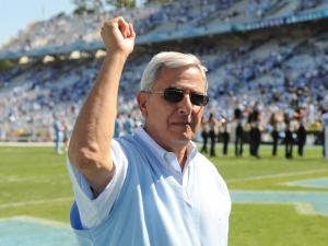 UNC Athletic Director Dick Baddour walks off the field following the UNC vs. Georgia Tech game, Saturday, Sept. 18, 2010 at Kenan Stadium in Chapel Hill.