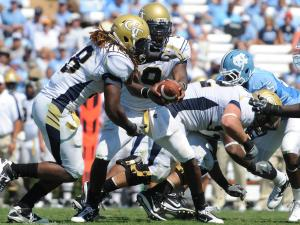 Josh Nesbitt (9) hands the ball of to Anthony Allen (18) during the UNC vs. Georgia Tech game, Saturday, Sept. 18, 2010 at Kenan Stadium in Chapel Hill.