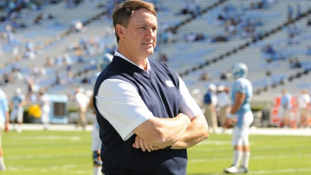Butch Davis watchs as his team comes onto the field before the UNC vs. ECU game at Kenan Stadium in Chapel Hill, N.C. on Saturday, October 2, 2010.