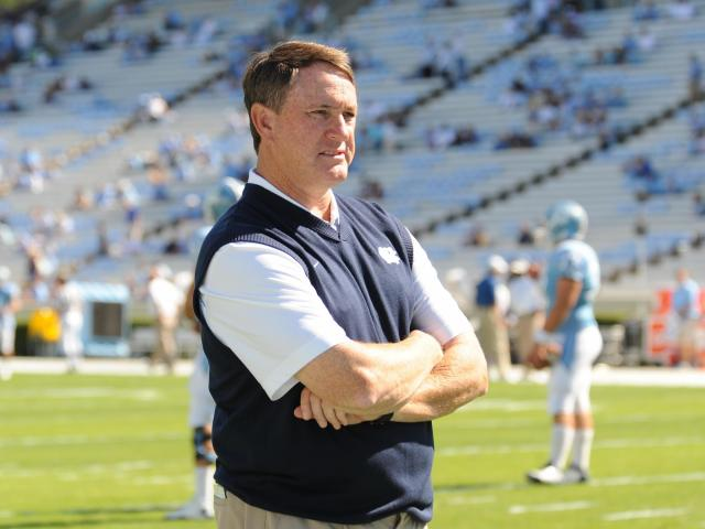 Butch Davis watchs as his team comes onto the field before the UNC vs. ECU game at Kenan Stadium in Chapel Hill, N.C. on Saturday, October 2, 2010. <br/>Photographer: Will Bratton
