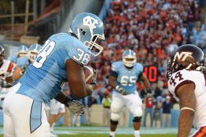 Curtis Byrd (38) lowers his shoulder to take a hit during the North Carolina Tar Heels vs. Virginia Tech Hokies game at Kenan Stadium in Chapel Hill, N.C. on Saturday, November 13, 2010.