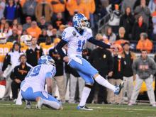 Casey Barth (11) kicks out of a Trase Jones (19) hold during the North Carolina Tar Heels vs. Tennessee Volunteers game, Wednesday, December 29, 2010 at the Franklin American Mortgage Music City Bowl in Nashville, TN.