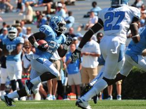 Romar Morris (21) runs in for a touchdown during the North Carolina Tar Heels spring football game in Chapel Hill, N.C. Saturday April 14, 2012.