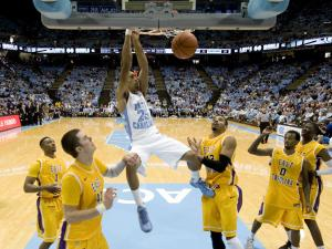 J.P Tokoto (25) dunks during the North Carolina Tar Heels vs. East Carolina Pirates NCAA basketball game, Saturday, December 15, 2012 in Chapel Hill, NC.