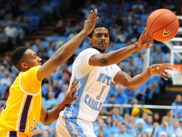 Dexter Strickland (1) completes a pass during the North Carolina Tar Heels vs. East Carolina Pirates NCAA basketball game, Saturday, December 15, 2012 in Chapel Hill, NC. <br/>Photographer: Will Bratton
