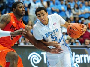 Marcus Paige (5) dribbles past a defender during the North Carolina Tar Heels vs. Virginia Tech Hokies NCAA basketball game, Saturday, February 2, 2013 in Chapel Hill, NC.