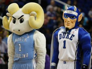 The Carolina and Duke mascots participate in Mascot Night during quarterfinals of the ACC Women's Basketball Tournament in Greensboro, N.C., Friday, March 8, 2013.