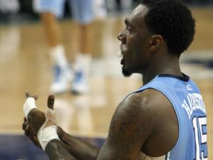 North Carolina's PJ Hairston holds his injured hand during the Tar Heels' 87-77 title game loss to Miami in the 60th ACC Tournament on Sunday, March 17, 2013 in Greensboro, NC (Photo by Jack Morton).