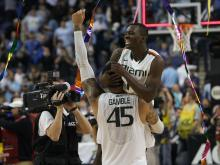 Top-seeded Miami beat North Carolina 87-77 Sunday to capture their first ACC Tournament championship.