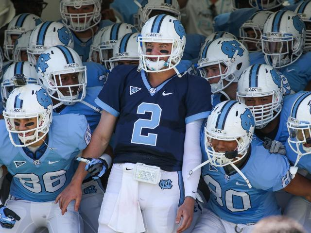 North Carolina Tar Heels quarterback Bryn Renner (2) and team prepare to take the field during the UNC Annual Spring Football game on Saturday, April 13, at Kenan Stadium in Chapel Hill North Carolina.  <br/>Photographer: Anthony Barham