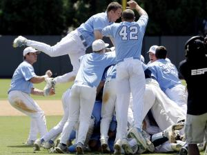 North Carolina players celebrate following their 5-4 win over South Carolina in an NCAA college baseball tournament super regional game in Chapel Hill, N.C., Tuesday, June 11, 2013. North Carolina advances to the College World Series. (AP Photo/Gerry Broome)