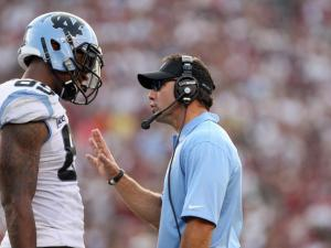 North Carolina coach Larry Fedora talks to Eric Ebron during the Tar Heels' clash with the South Carolina Gamecocks on Thursday, August 29, 2013 in Columbia, SC (Photo by Jack Morton).
