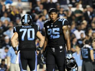 North Carolina's Eric Ebron makes eyes with the Miami sideline during the Tar Heels' 27-23 loss to Miami on Thursday, October 17, 2013 in Chapel Hill, NC (Photo by Jack Morton).