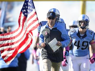 UNC head coach Larry Fedora leads the Tar Heels out of the tunnel before play at Kenan Stadium between the University of North Carolina Tar Heels and the Boston College Eagles on October 26, 2013 in Chapel Hill, NC.