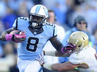 UNC tailback T.J. Logan (8) runs with the ball after a catch during play at Kenan Stadium between the University of North Carolina Tar Heels and the Boston College Eagles on October 26, 2013 in Chapel Hill, NC.