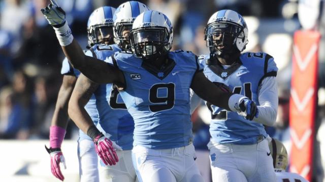 UNC linebacker Travis Hughes (9) reacts after a big stop in the first half of play at Kenan Stadium between the University of North Carolina Tar Heels and the Boston College Eagles on October 26, 2013 in Chapel Hill, NC.