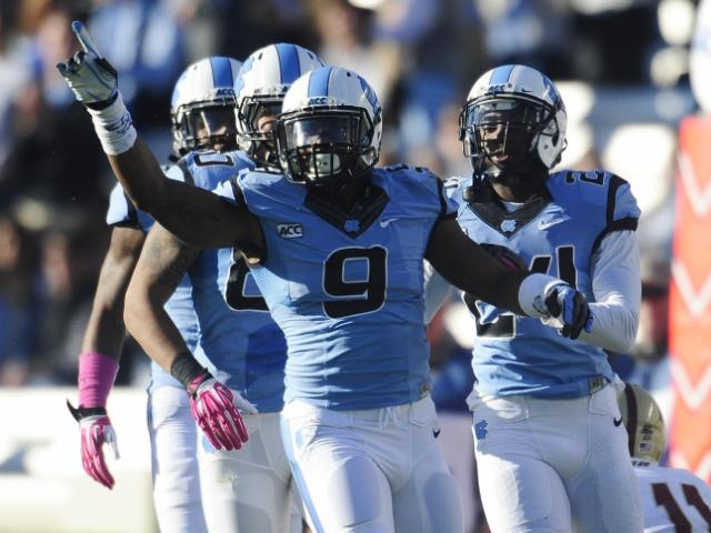 UNC linebacker Travis Hughes (9) reacts after a big stop in the first half of play at Kenan Stadium between the University of North Carolina Tar Heels and the Boston College Eagles on October 26, 2013 in Chapel Hill, NC.  <br/>Photographer: Will Bratton