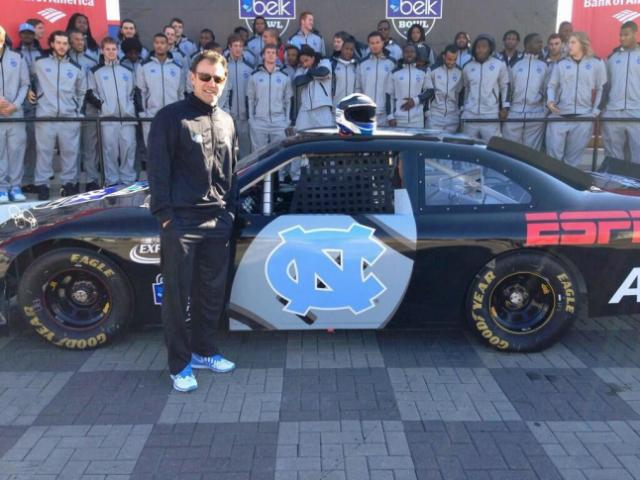 On Tuesday, they did the NASCAR thing at Charlotte Motor Speedway where Director of Athletics Bubba Cunningham tweeted a photo of head football coach Larry Fedora with a UNC-themed car. (Source: Twitter / BubbaUNC)
