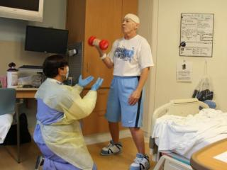 UNC women's basketball coach Sylvia Hatchell exercising in the hospital during her fight with leukemia.