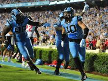 UNC scored four times in less than four minutes late in the third quarter Saturday to overcome a slow start and beat Liberty, 56-29 at Kenan Staduim.