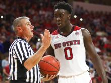 Abdul-Malik Abu (0) talks with a referee during the game. North Carolina defeated NC State by a score of 80-68 on February 24, 2016 at the PNC Arena in Raleigh, North Carolina . (Photo by: Jerome Carpenter/WRAL Contributor)