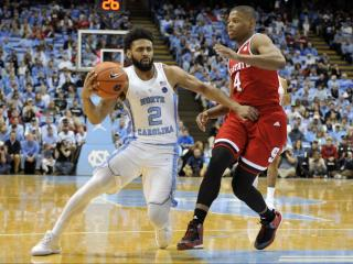 Joel Berry II (2) brings the ball up the court during NCAA basketball action at the Dean E. Smith Center between the North Carolina Tar Heels and the NC State Wolfpack on January 8, 2017 in Chapel Hill, NC. (Will Bratton/WRAL contributor)