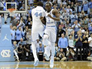 Justin Jackson (44) and Theo Pinson (1) react to play during NCAA basketball action at the Dean E. Smith Center between the North Carolina Tar Heels and the NC State Wolfpack on January 8, 2017 in Chapel Hill, NC. (Will Bratton/WRAL contributor)