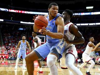 Kennedy Meeks (3) in the post against Abdul-Malik Abu (0). Carolina defeats NC State 97-73 at the PNC Arena in Raleigh, NC on February 15, 2017. (Photo by: Jerome Carpenter/WRAL Contributor)