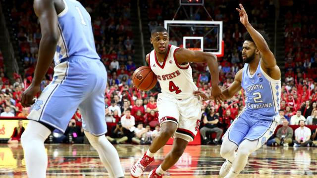 Dennis Smith Jr. (4) drives against Joel Berry II (2). Carolina defeats NC State 97-73 at the PNC Arena in Raleigh, NC on February 15, 2017. (Photo by: Jerome Carpenter/WRAL Contributor)