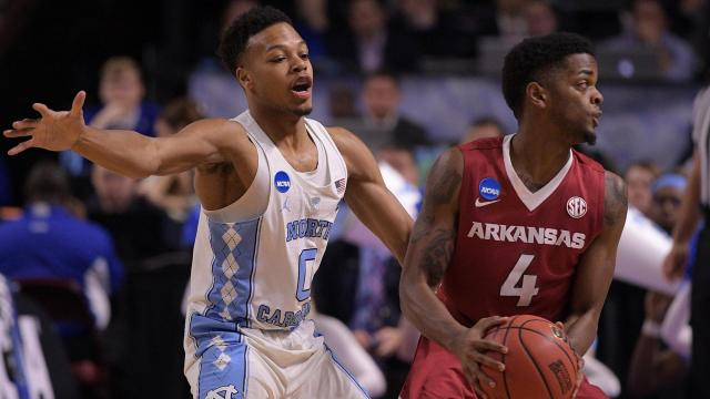 Nate Britt (0) of the North Carolina Tar Heels defends Daryl Macon (4) of the Arkansas Razorbacks during the second round of the 2017 NCAA Men's Basketball Tournament at Bon Secours Wellness Arena on March 19, 2017 in Greenville, South Carolina. (Lance King/WRAL contributor)