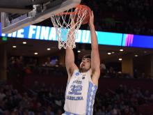 UNC escapes Arkansas upset bid in 72-65 tourney win
