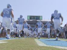 UNC football exits tunnel