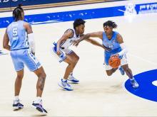 UNC's Caleb Love dribbles against Duke