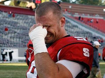 NC State senior Marcus Stone fights back the tears as he walks off of the field at Carter-Finley Stadium for the last time on November 24, 2007.