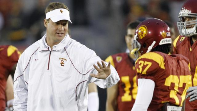 FILE: Southern California head coach Lane Kiffin, left, talks with cornerback Nickell Robey during pregame warm-ups before an NCAA college football game against Virginia in Los Angeles on Saturday, Sept. 11, 2010. (AP Photo/Danny Moloshok)