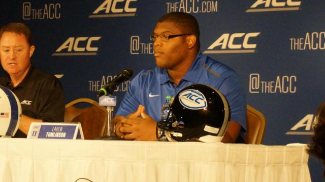Duke's Laken Tomlinson answers questions from the media on the first day of the ACC Football Kickoff at the Grandover in Greensboro, July 20, 2014.
