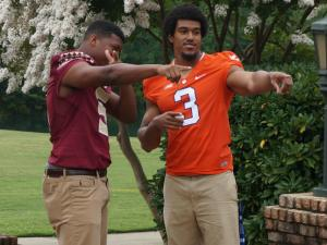 Florida State's Jameis Winston and Clemson's Vic Beasley on the first day of the ACC Football Kickoff at the Grandover in Greensboro, July 20, 2014.