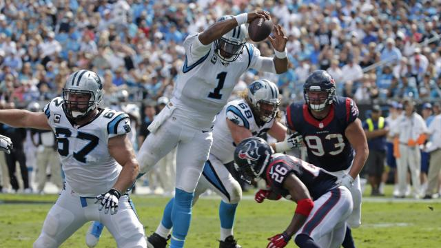 Carolina Panthers' Cam Newton (1) leaps for a touchdown against the Houston Texans during the second half of an NFL football game in Charlotte, N.C., Sunday, Sept. 20, 2015. (AP Photo/Chuck Burton)