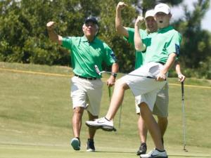 Team McCreery celebrates Scotty's birdie at the 19th annual Jimmy V Celebrity Golf Classic on August 26, 2012 at the Lonnie Poole Golf Course in Raleigh, NC.