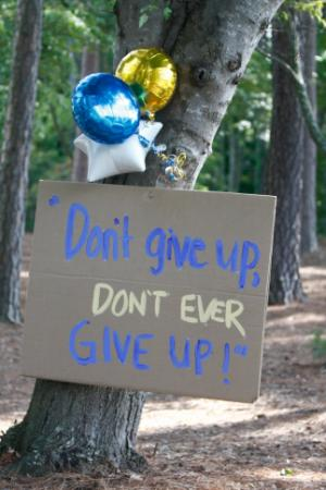 A sign along the cart path remembers Jimmy V's famous words.  The 20th annual Jimmy V. Celebrity Golf Classic took place  on August 25, 2013 at the North Ridge Country Club in Raleigh, NC.