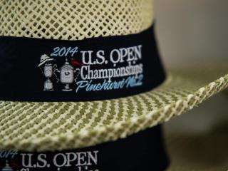 106 thousand hats are available for golf fans at the Merchandise Pavillion during the 2014 US Open Championship in Pinehurst, NC. (photographer: Scott Clevenger)