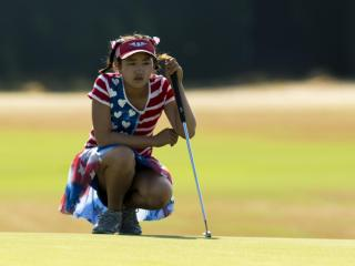 Lucy Li lines up her putt on the 18th hole during the first round at the 2014 U.S. Women's Open at Pinehurst Resort & C.C. in Village of Pinehurst, N.C. on Thursday, June 19, 2014.  (Copyright USGA/John Mummert)