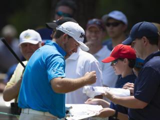 Graeme McDowell signs autographs for fans during a practice round before the 2014 U.S. Open at Pinehurst Resort & C.C. in Village of Pinehurst, N.C. on Wednesday, June 11, 2014.  (Copyright USGA/Michael Cohen)