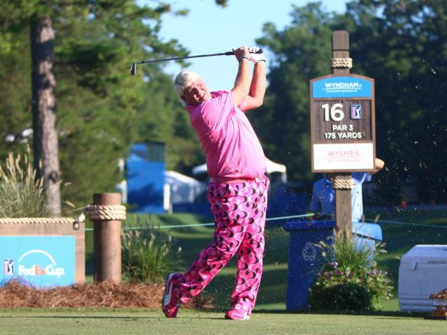 John Daly tees off on the 16th hole on the first day of the 2014 Wyndham Championship. Sedgefield Country Club hosted the 2014 Wyndham Championship on August 14, 2014 in Greensboro, North Carolina. (Jerome Carpenter/WRAL Contributor)<br/>Photographer: Jerome  Carpenter