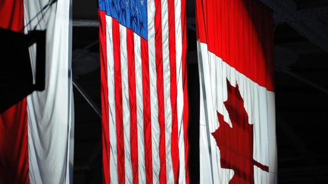 The spot light on the American and Canadian Flags during todays National Anthem.Charlotte Checkers defeat Norfolk Admirals  3-1 at PNC Arena in Raleigh North Carolina. (Photos By Anthony Barham)