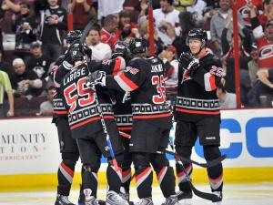 The 'Canes celebrate Chad LaRose's 19th goal of the season.  Photo by Mike Hurst.