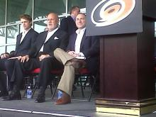 On the dias at the RBC Center (from left): Hurricanes captain Eric Staahl, team owner Peter Karmanos, NHL Commissioner Gary Bettman.