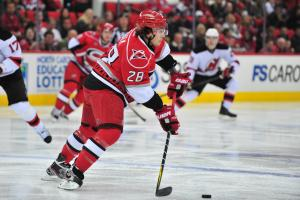 Justin Faulk (28) skates with the puck during the Carolina Hurricanes vs. New Jersey Devils hockey game in Raleigh, N.C., Monday, December 26, 2011.