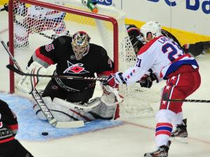Justin Peters (35) makes a save during the Carolina Hurricanes vs. Washington Capitals NHL hockey game in Raleigh, N.C. Monday, February 20, 2012.