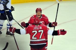 Jeff Skinner (53) and Derek Joslin (27) celebrate a goal during the Carolina Hurricanes vs. Winnipeg Jets NHL hockey game in Raleigh, N.C. Friday, March 30, 2012.